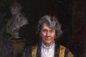 Oil painting of a woman with grey hair in the RCP presidential gown, holding a silver caduceus, seated in front of two indistinct sculpted busts of men