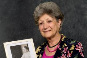 Dame Fiona Caldicott holding a photograph of Dr Helen Boyle