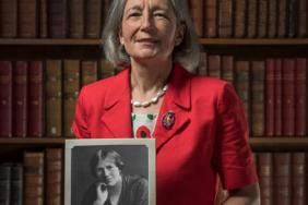 Clare Marx holding a photograph of Eleanor Davies-Colley