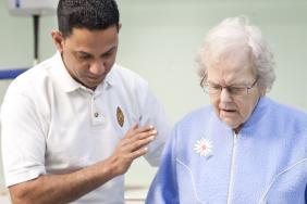 Nurse helps old lady
